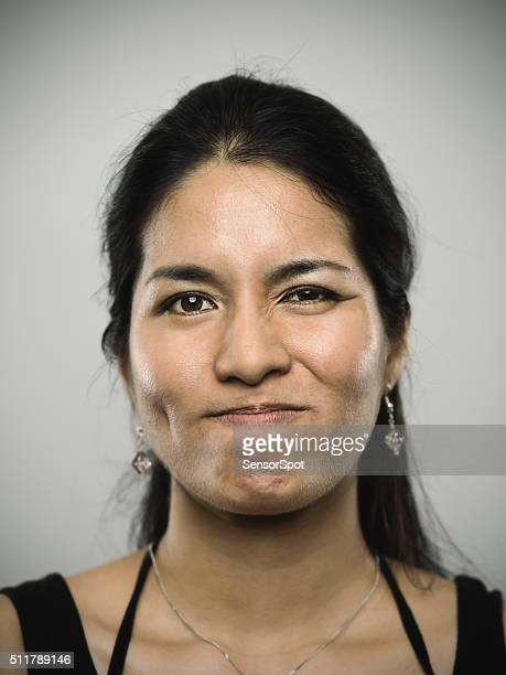 Portrait of a young mixed race woman looking at camera