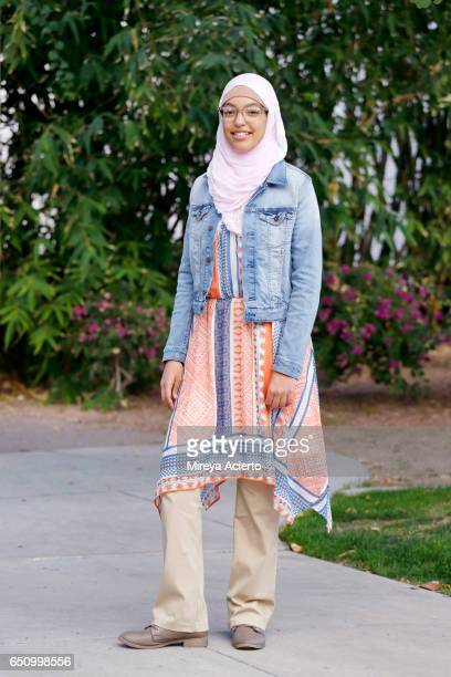Portrait of a young Muslim teenanger outside