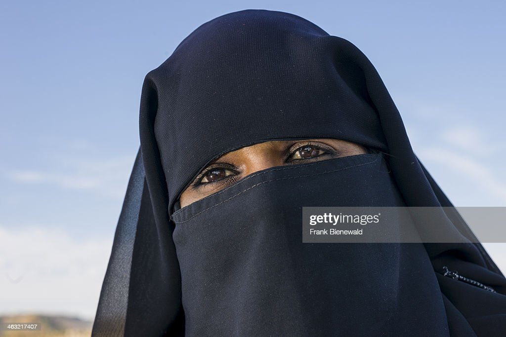 AURANGABAD MAHARASHTRA INDIA A portrait of a young muslim woman covering her face by a black veil hijab and visiting the Bibikamaqbara built in 1660...