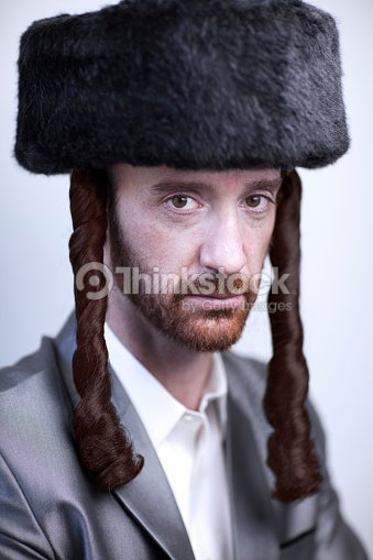 b9a275f7252 Portrait of a young orthodox Hasdim Jewish man with red beard and black fur  hat in