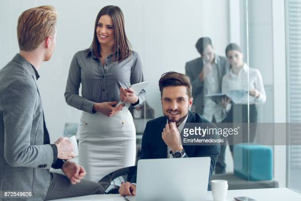 Portrait of a young smiling businessman at work