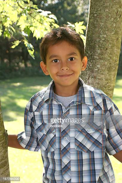 Portrait of a young smiling Hispanic boy outdoors