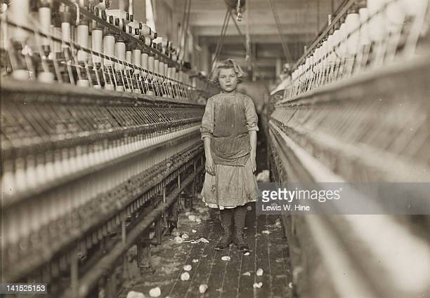 Portrait of a young spinner in a cotton mill August Georgia 1909 A spinner's job was to continually walk along the aisles of spinning machines...