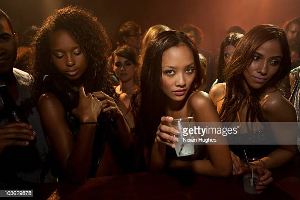 Portrait of a young woman at a nightclub