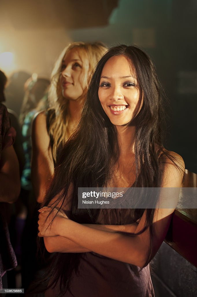 Portrait of a young woman at a nightclub : Stock Photo