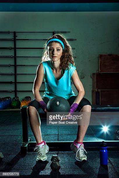 Portrait of a young woman carrying a medicine ball