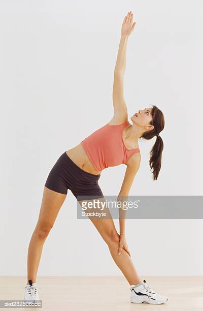 Portrait of a young woman doing stretching exercises