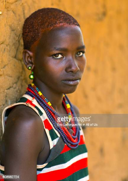 Portrait of a young woman from Hamer tribe with short hair Omo valley Turmi Ethiopia on June 5 2017 in Turmi Ethiopia