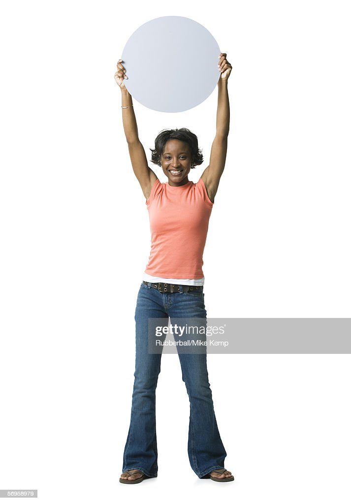Portrait of a young woman holding a blank sign : Stock Photo