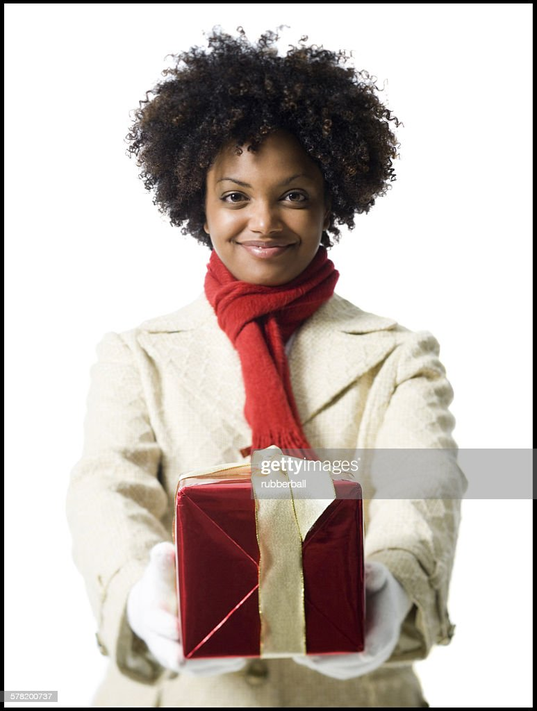 Portrait of a young woman holding a gift box