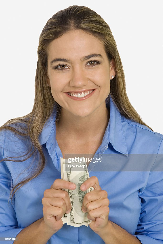 Portrait of a young woman holding American paper currency : Foto de stock