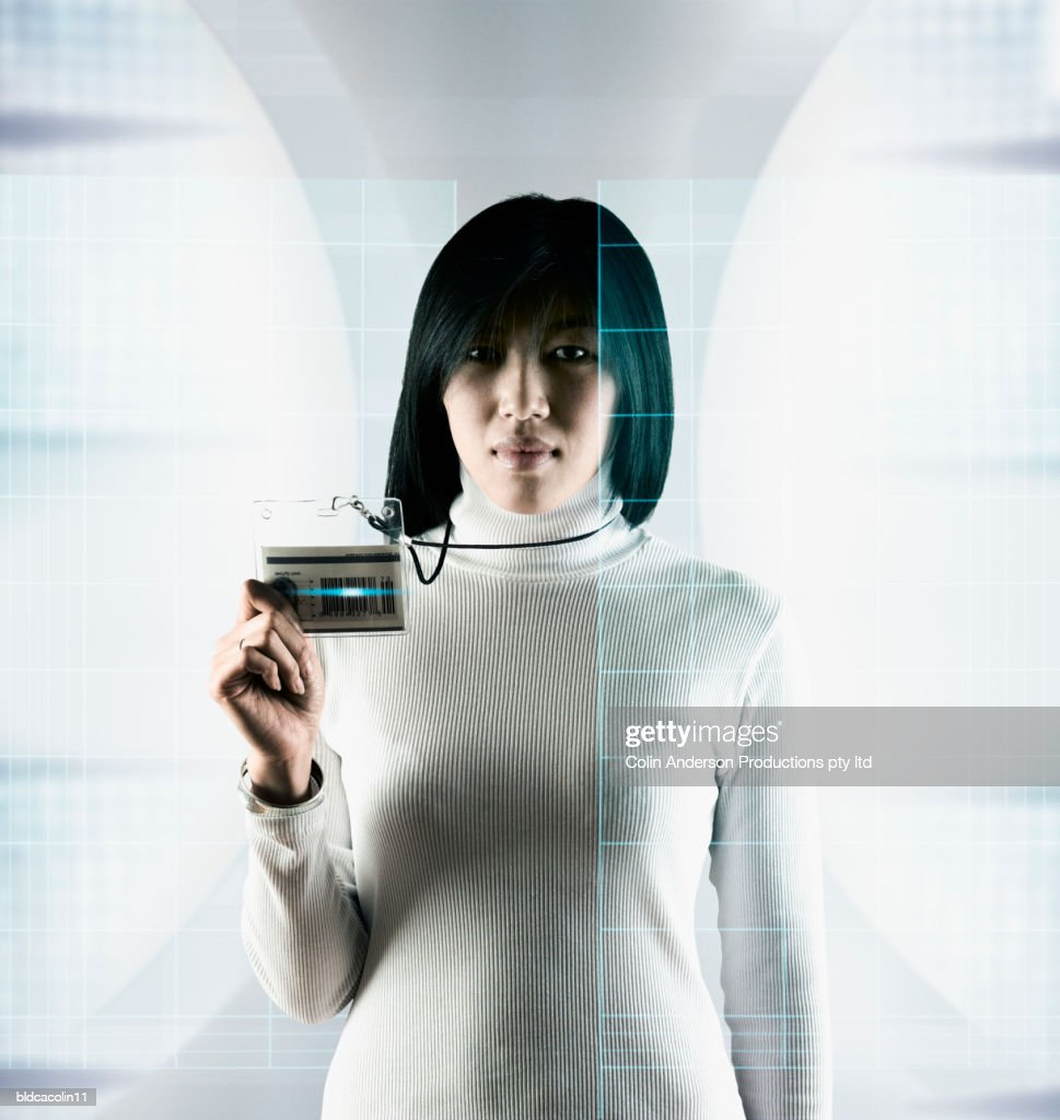 Portrait of a young woman holding an identity card