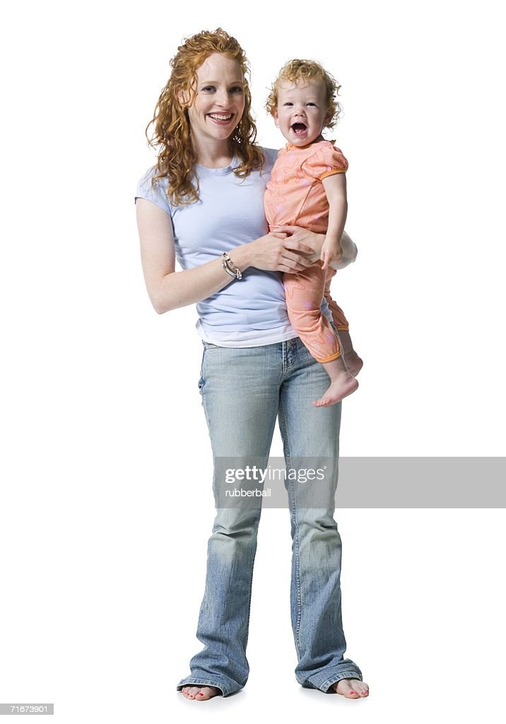 Portrait of a young woman holding her daughter : Stock Photo