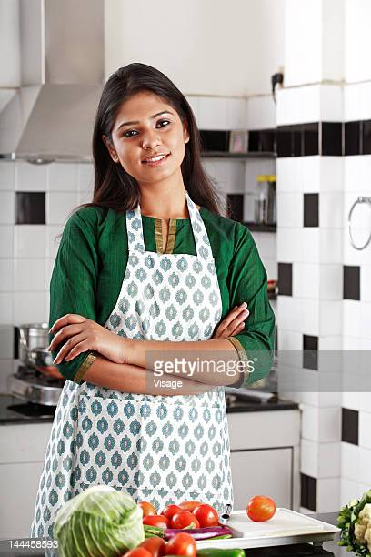 Portrait of a young woman in a kitchen