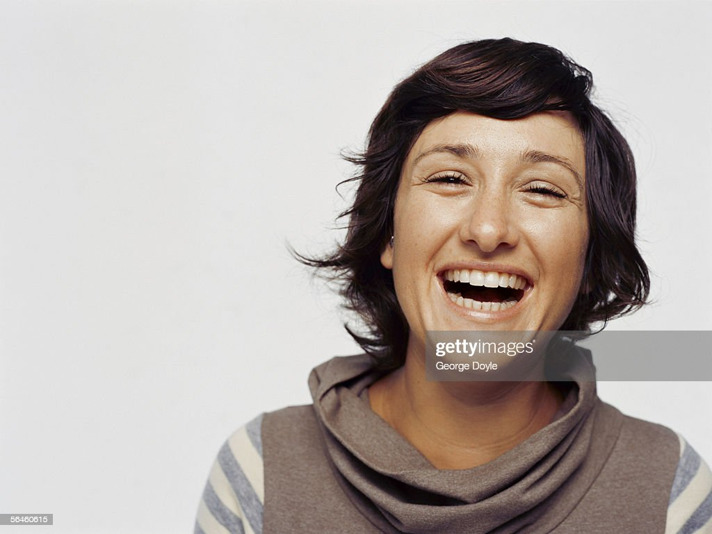 portrait of a young woman laughing : Stock Photo