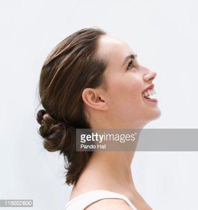 Portrait of a young woman laughing, side view