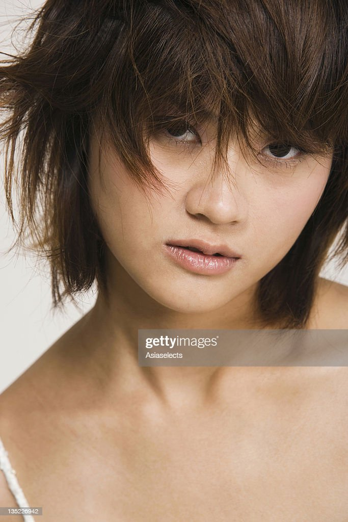 Portrait of a young woman looking serious : Stock Photo