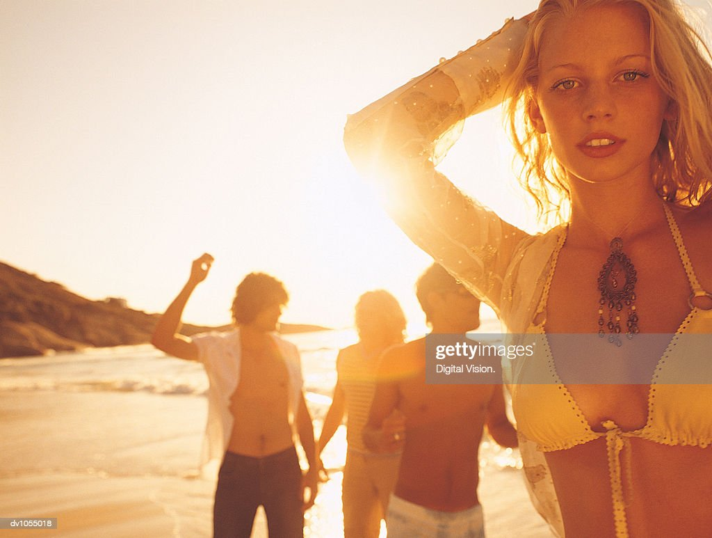 Portrait of a Young Woman on the Beach at Sunset : Stock Photo