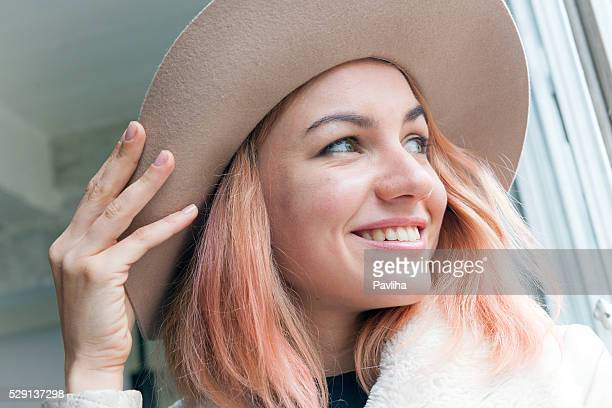 Portrait of a young woman, pink hair, hat, Paris, France