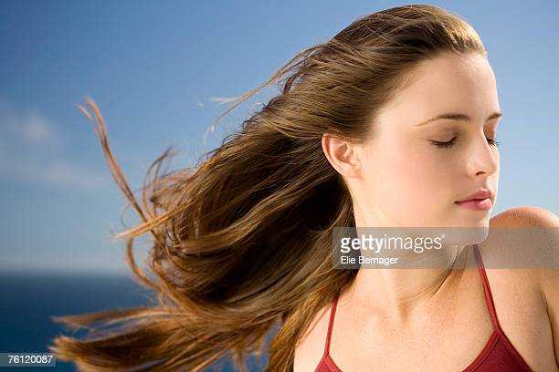 Portrait of a young woman, shut eyes, outdoors