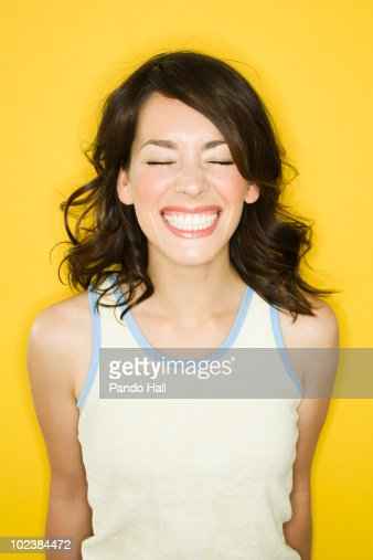 Portrait of a young woman smiling, eyes closed