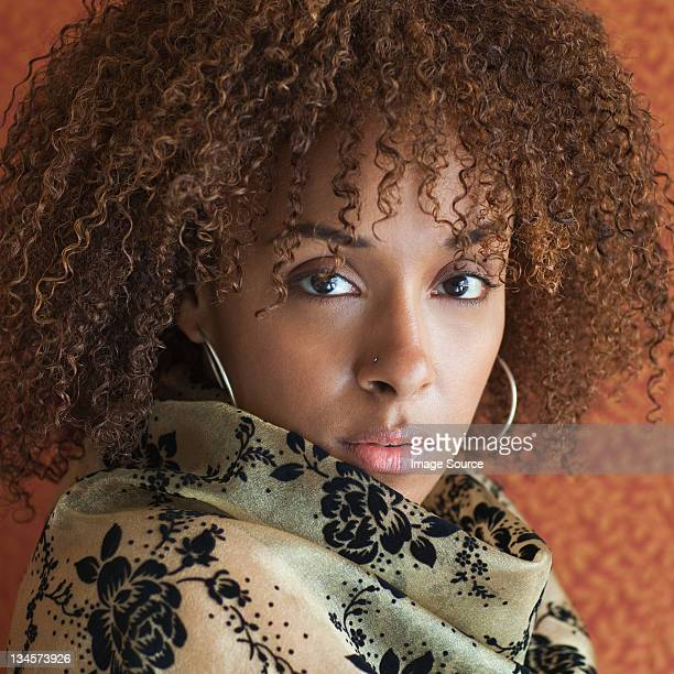 Portrait of a young woman staring at the camera with attitude