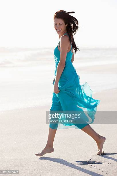 Portrait of a young woman walking on beach