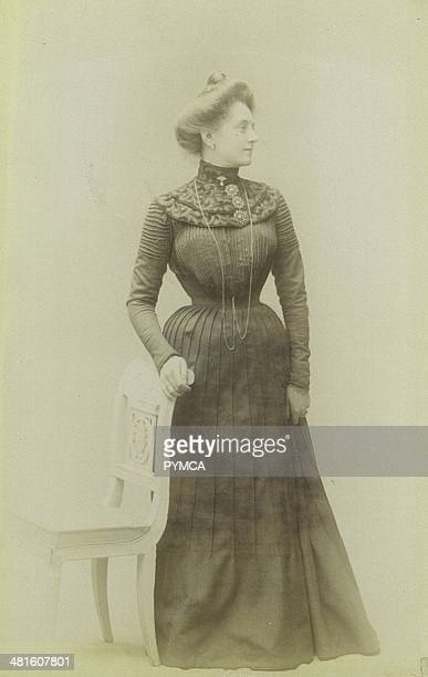 Portrait of a young woman wearing a corset under her dress Victorian fashion circa 1890s