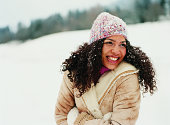 Portrait of a Young Woman Wearing a Hat in the Snow