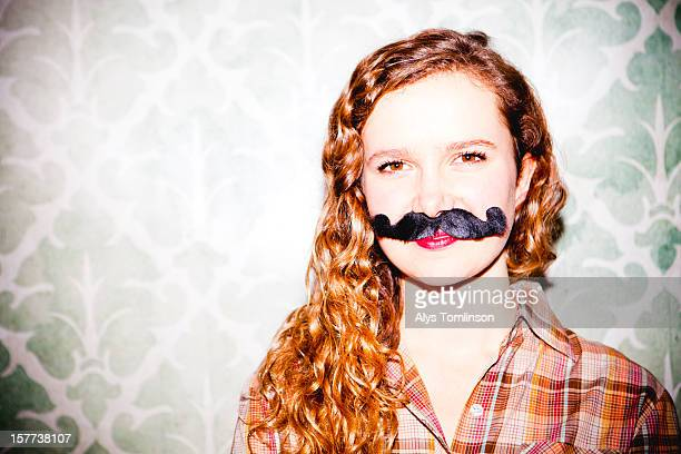 Portrait of a young woman wearing a moustache