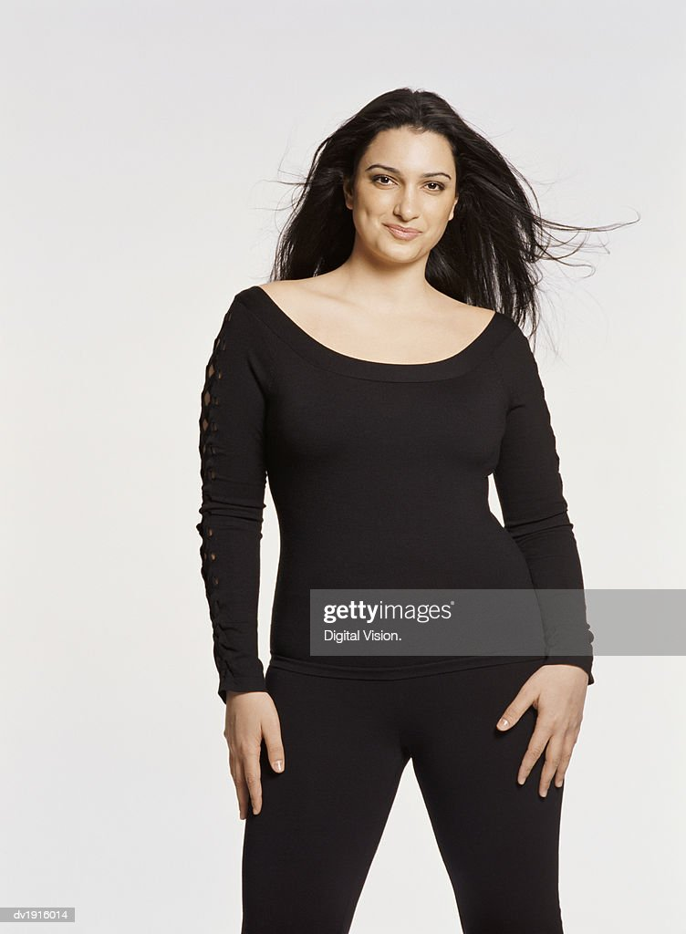 Portrait of a Young Woman Wearing Black Clothing Against a White Background
