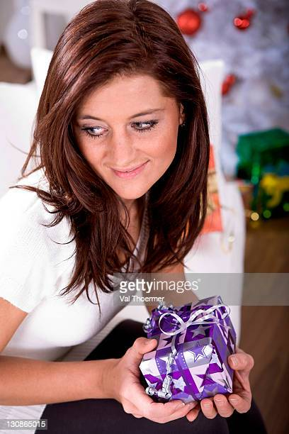 Portrait of a young woman with a Christmas present