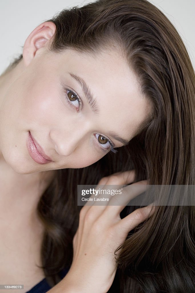 Portrait of a young woman with hand in hair : Stock Photo