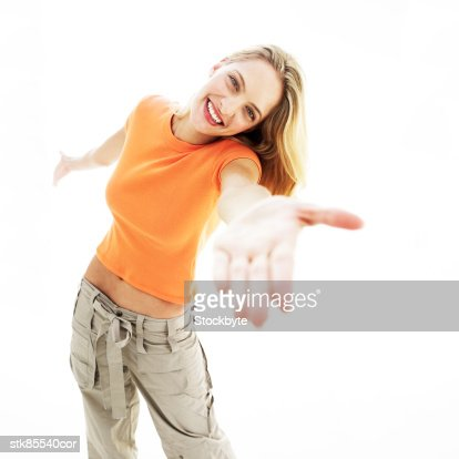 portrait of a young woman with her arm outstretched in front of her : Stock Photo