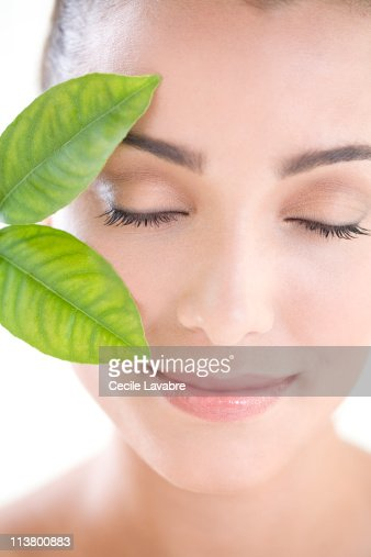 Portrait of a young woman with leaves : Stock Photo