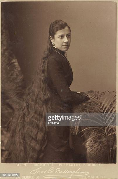 Portrait of a young woman with very long hair circa 1900s