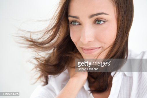 Portrait of a young woman with windblown hair : Stock Photo