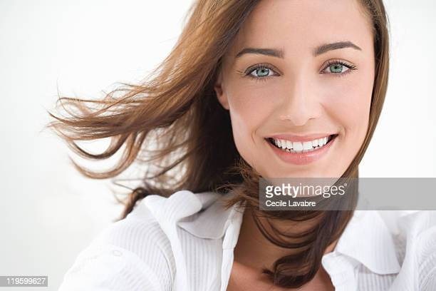 Portrait of a young woman with windblown hair