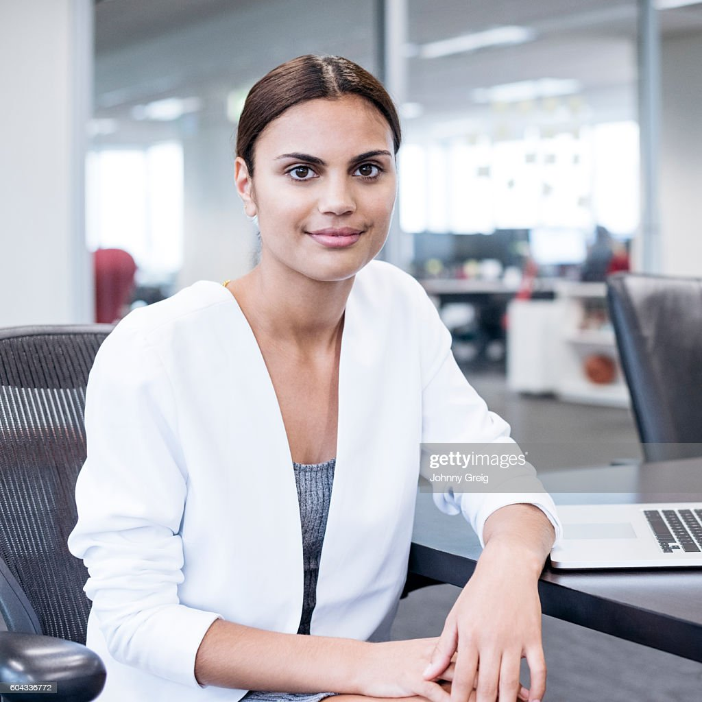 Portrait of Aboriginal Australian woman in office : Stock Photo