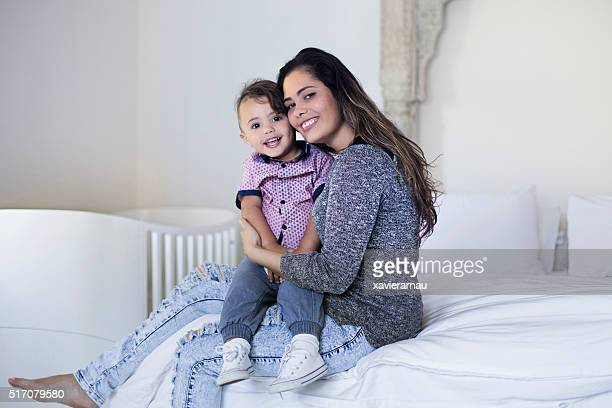 Portrait of Aboriginal mother and son in the bedroom