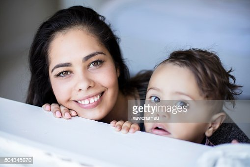 Portrait of Aboriginal mother and son looking to the window