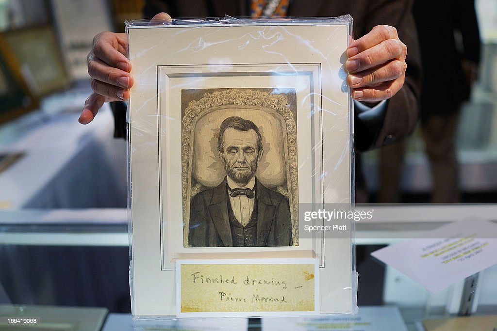 A portrait of Abraham Lincoln lying in state is held by Daniel Weinberg of the Abraham Lincoln Bookshop during the New York Antiquarian Book Fair on April 12, 2013 in New York City. This years fair, the 53rd year and held at the Park Avenue Armory, features over 200 exhibitors of rare books, maps, manuscripts and ephemera.The New York Antiquarian Book Fair runs from April 11 through 14.
