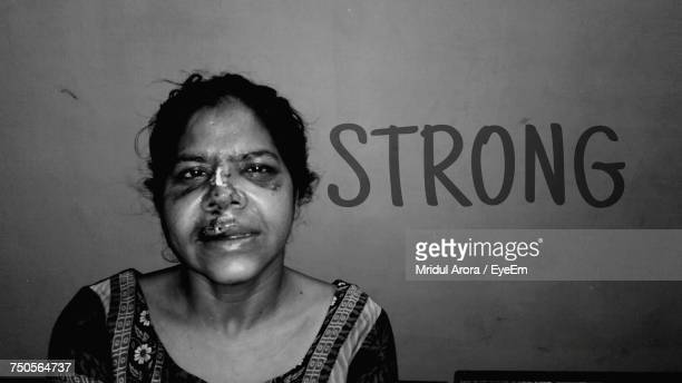 Portrait Of Acid Victim With Text On Wall