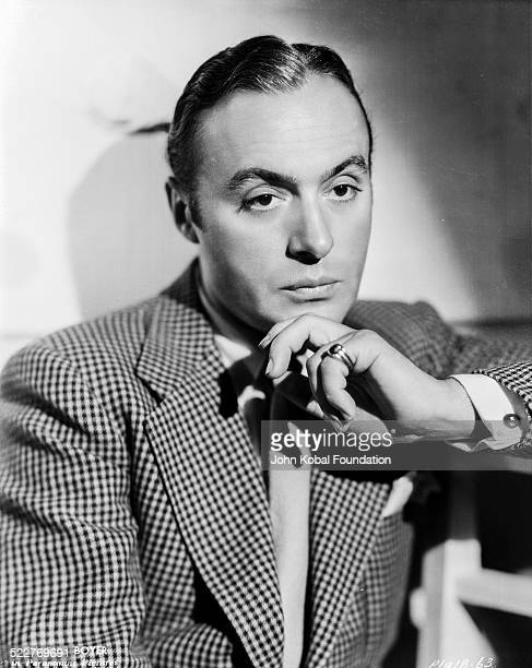 Portrait of actor Charles Boyer wearing a check jacket for Paramount Pictures 1933