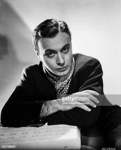 Portrait of actor Charles Boyer wearing a cravat for MGM Studios 1937