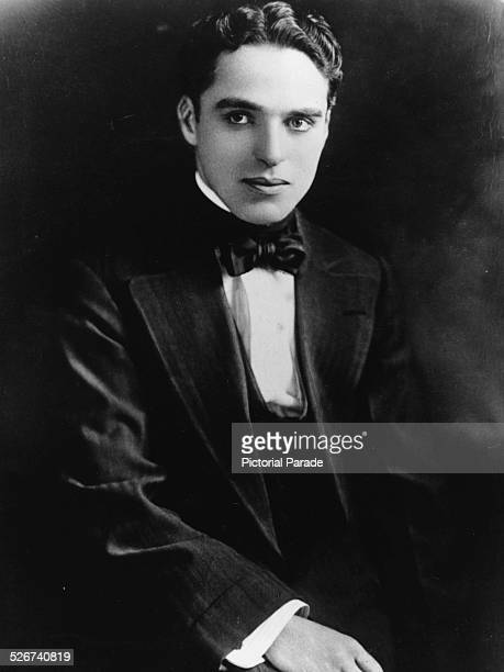 Portrait of actor Charlie Chaplin wearing a suit and bowtie circa 1910