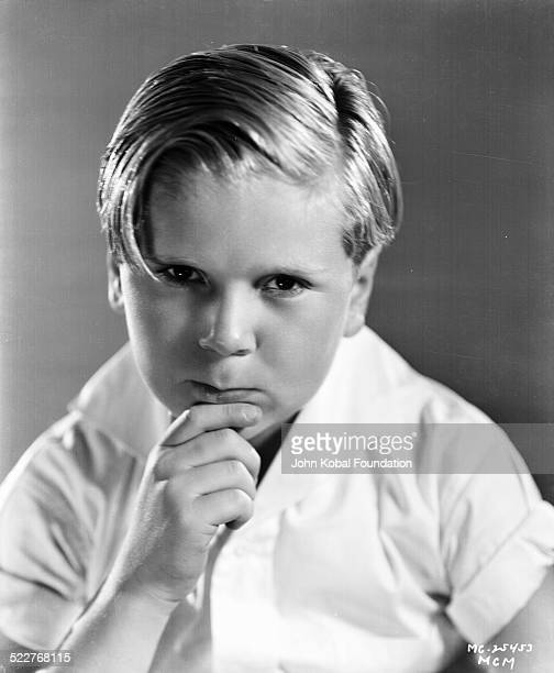 Portrait of actor Jackie Cooper wearing a short sleeved shirt for MGM Studios August 2nd 1932