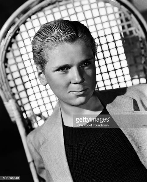 Portrait of actor Jackie Cooper wearing a sweater and jacket for MGM Studios March 10th 1936