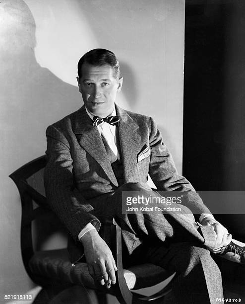 Portrait of actor Maurice Chevalier wearing a suit and bowtie for MGM Studios February 15th 1934