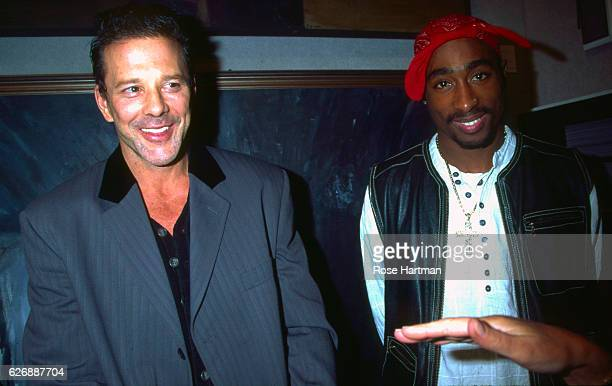 Portrait of actor Mickey Rourke and Rap musician Tupac Shakur as they pose together at benefit auction for Intercambios Culturales Project for El...
